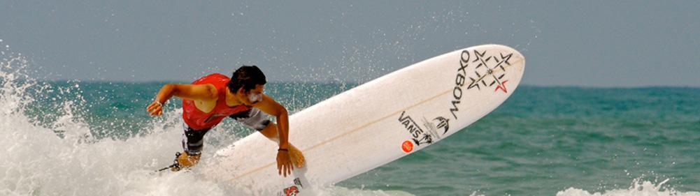 Powerful surfer ride longboards in challenging south west France waves